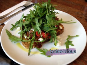 Slow braised lamb on toasted sourdough with marinated roasted peppers, feta and rocket