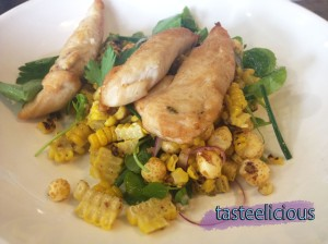 Chicken Tenderloins served with a Char-Grilled Corn, Red Onion, Chive and Ruffed Corn Salad with a Smoked Almond Dressing